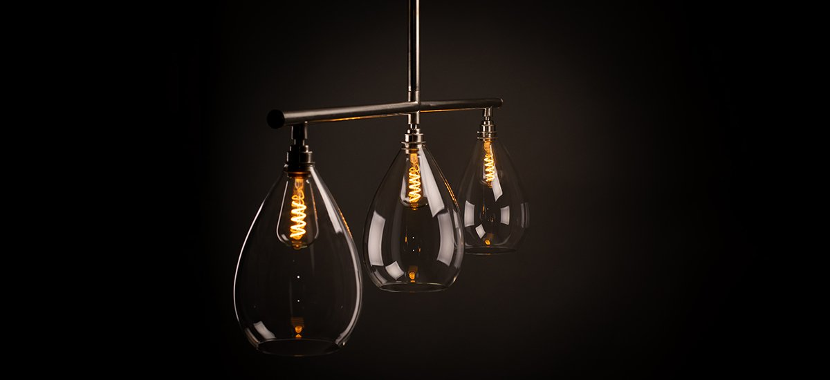 Bespoke-lighting-handblown-glass-pendant-on-industrial-conduit-bar