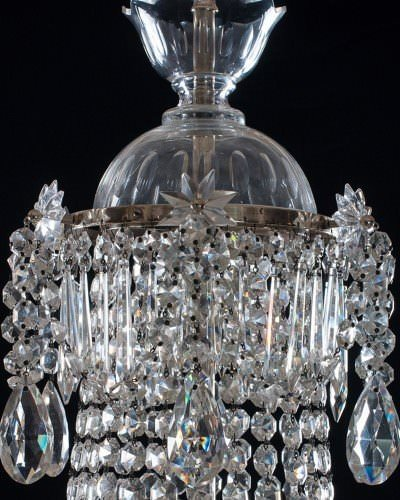 Tope of antique crystal chandelier, waterfall and bag style with silver plate metalwork.