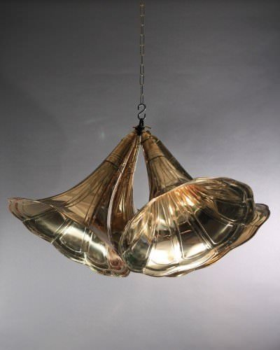 Gramophone trumpet pendant lights hung in group