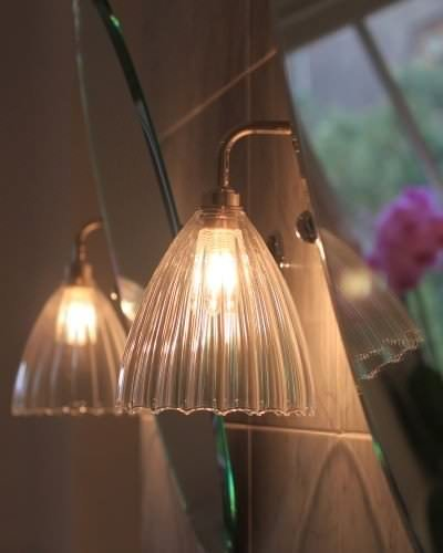 Handblown ribbed glass Ledbury bathroom contemporary wall lights either side of a mirror