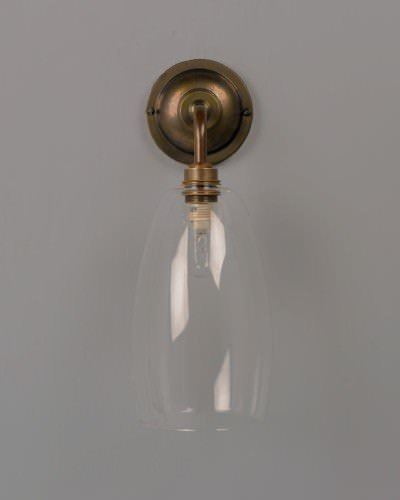 Upton clear glass contemporary bathroom wall light in antique brass ip44