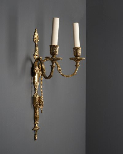 Pair of directoire style sconces with ramshead details