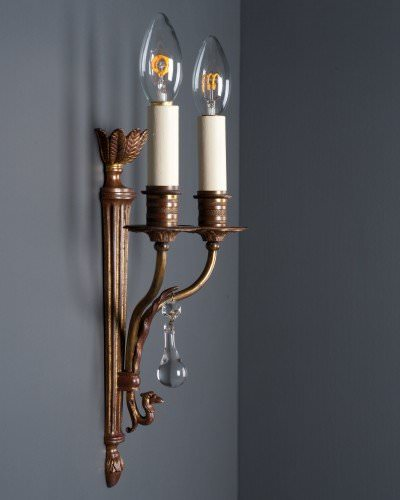 Pair of gilt wall sconces with hand pinned crystal dropper