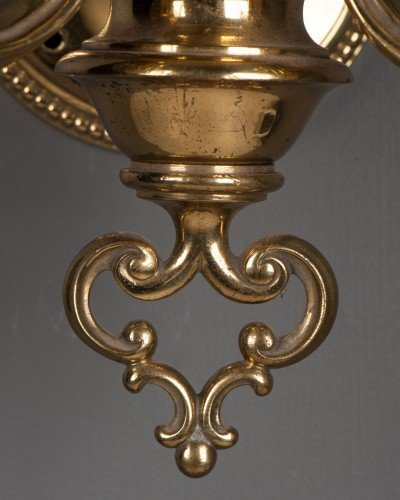 Impressive double arm antique wall lights with cut glass crystal brass detail base close up
