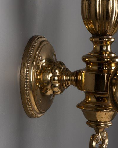 Impressive double arm antique wall lights with cut glass crystal brass backplate