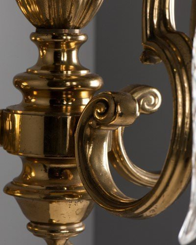 Impressive double arm antique wall lights with cut glass crystal brass detail backplate close up