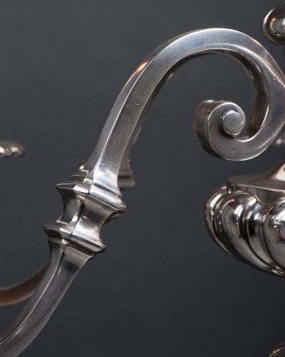 antique chandelier close up of silver plate arm