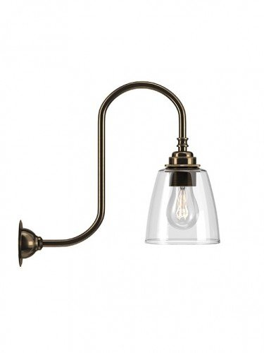 Swan neck wall light with Clear hand blown glass Pixley shade in Antique Brass