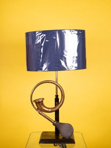 Converted vintage car horn table lamp, featured in Fritz Fryer sale.