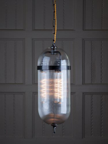 The Aston pendant has a retro look featured here with skinny ribbed handblown glass and bronze metalwork