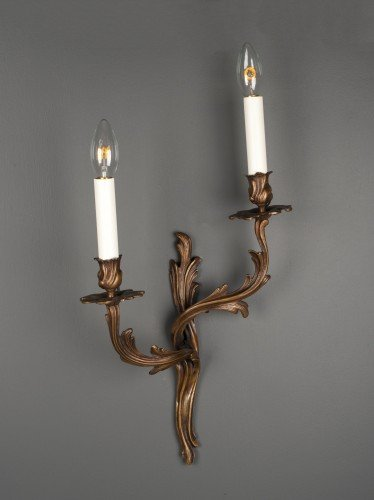 Antique rococo wall sconces unlit
