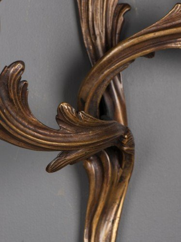Branch detail of pair of two branch rococo antique wall sconces