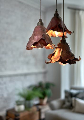 Gorsley pendant lights are hand made from copper and displayed in a sitting room