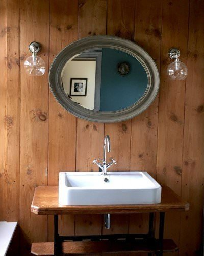 designer lighting clear Hereford contemporary bathroom wall lights either side of a mirror in bathroom