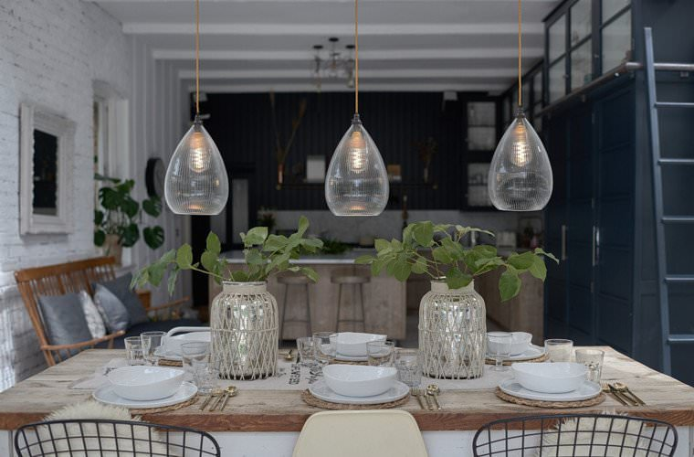Teardrop shape pendant lights hung over a table, our skinny ribbed Wellington glass shades offer a contemporary twist to traditional prismatic glass.