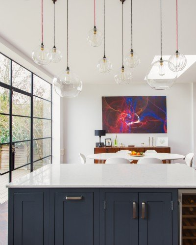 A Beautiful Shaker Kitchen Design Featuring Mixed Hereford Globe Pendant Lights