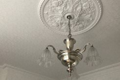 A gorgeous antique chandelier pictured in its new home