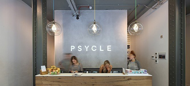 Clear-hereford-globe-pendant-lights-with-plumen-bulbs-at-psycle-gym-London